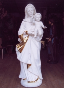 gilded statue before the painting