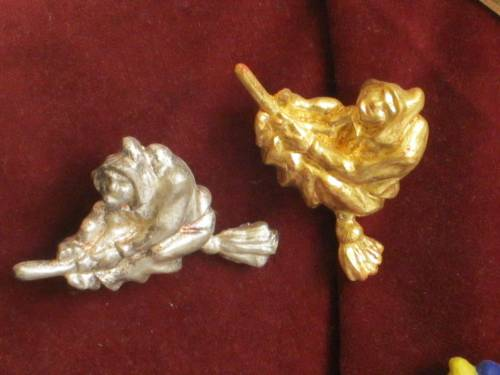 gilded and silver coated brooches
